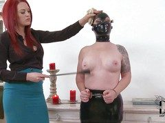 Promoter Deelight is a masked slave girl that gets her
