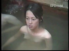 Young naked Asians in the public tub are luxurious